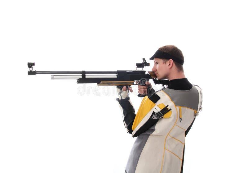Man taking aim with an air rifle stock photo