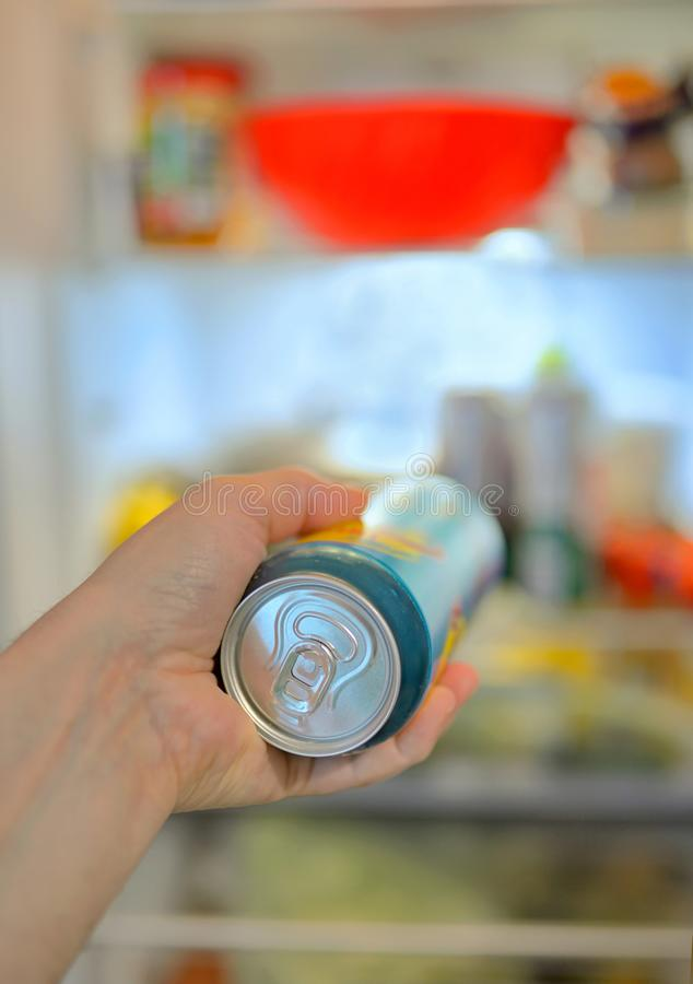 Man taking beer from fridge stock image