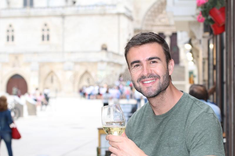 Man taking a break with delicious looking white wine stock photos