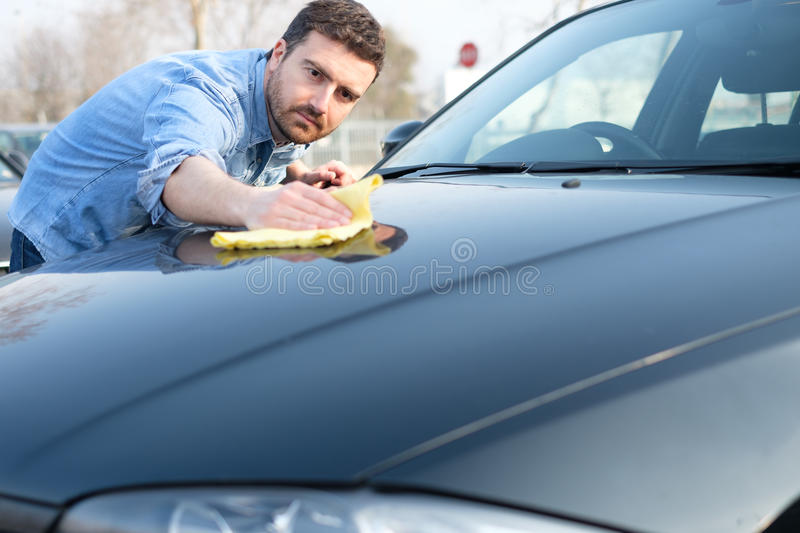 Man taking care and cleaning his car royalty free stock image