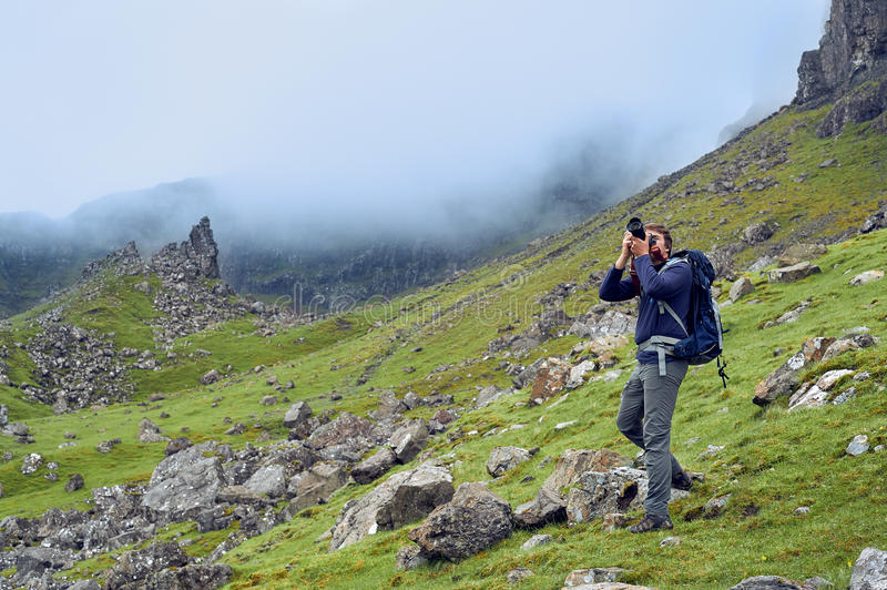Man taking images of the beautiful scottish landscape royalty free stock photo