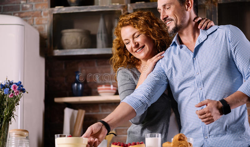 Man taking jar from the table stock images