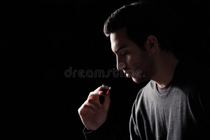 Man Taking Lords Supper. Young Man Taking The Lords Supper royalty free stock photography