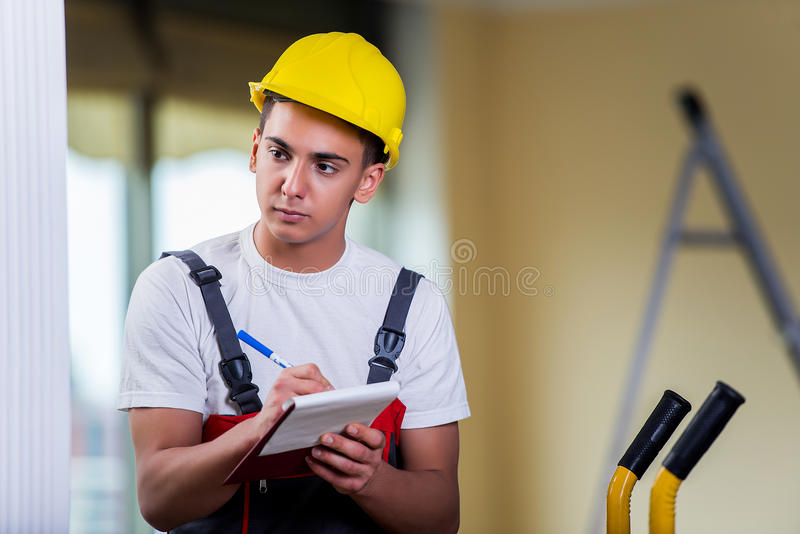 The man taking notes for delivery of boxes royalty free stock photography