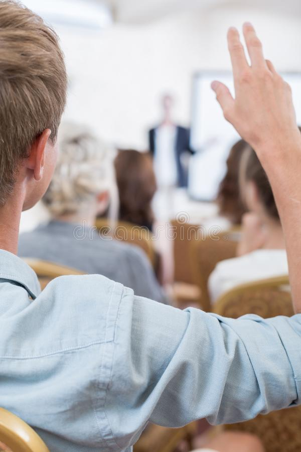 Man taking part in panel. Close up of men taking part in discussion panel stock photo