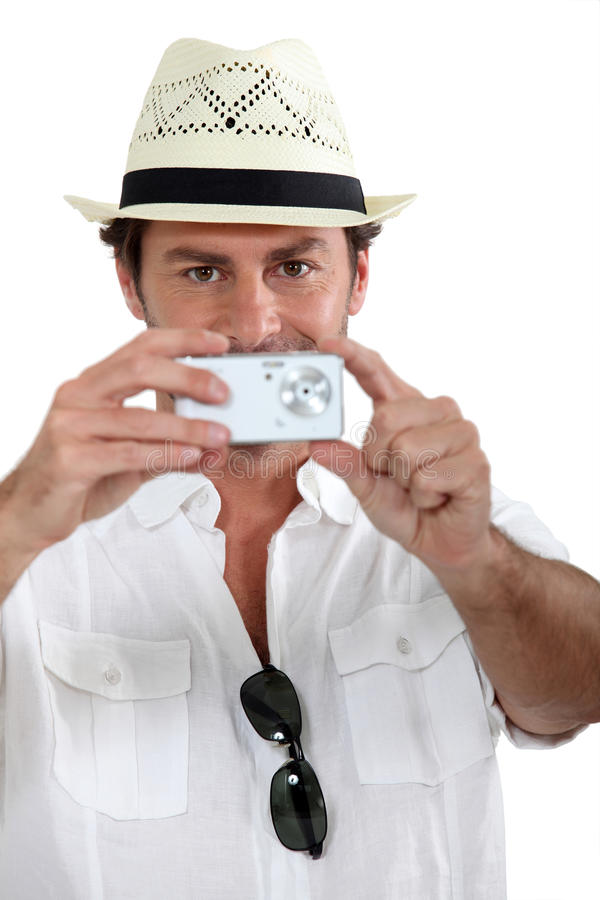 Download Man taking a photo stock image. Image of well, straw - 23793471