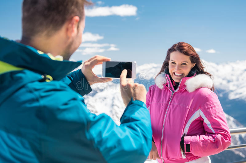 Man taking photo of girlfriend stock photos