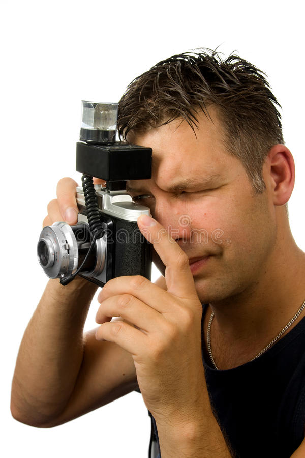 Man is taking photo with old fashioned camera