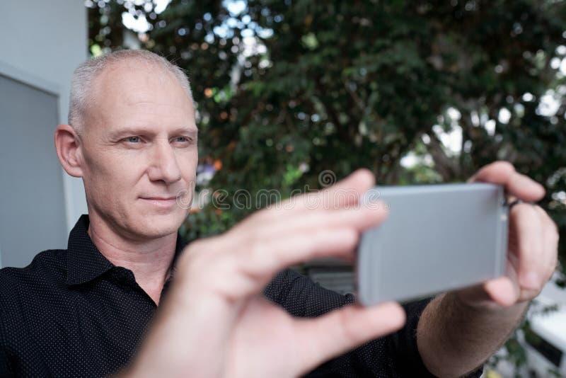 Man Taking Photo On Smartphone royalty free stock image