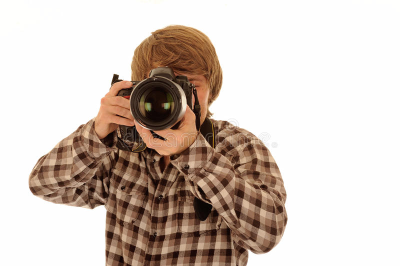 Man taking photograph. Man with auburn hair in check shirt taking photograph with camera, isolated on white background royalty free stock photos
