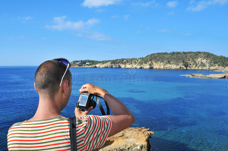 Man taking a picture in Ibiza Island, Spain stock photos