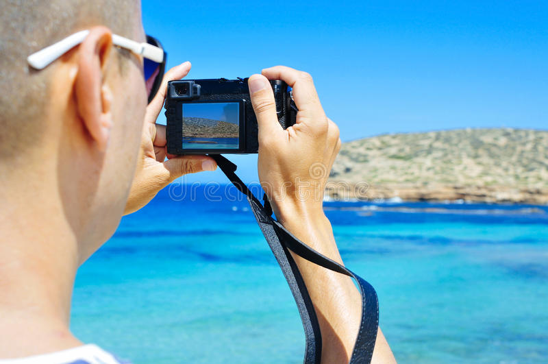 Man taking a picture in Ibiza Island, Spain royalty free stock photos