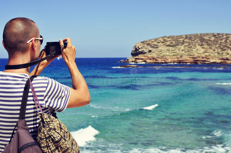 Man taking a picture in Ibiza Island, Spain stock photo