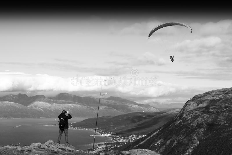 Man taking picture of Norway kite flyer background. Hd stock image