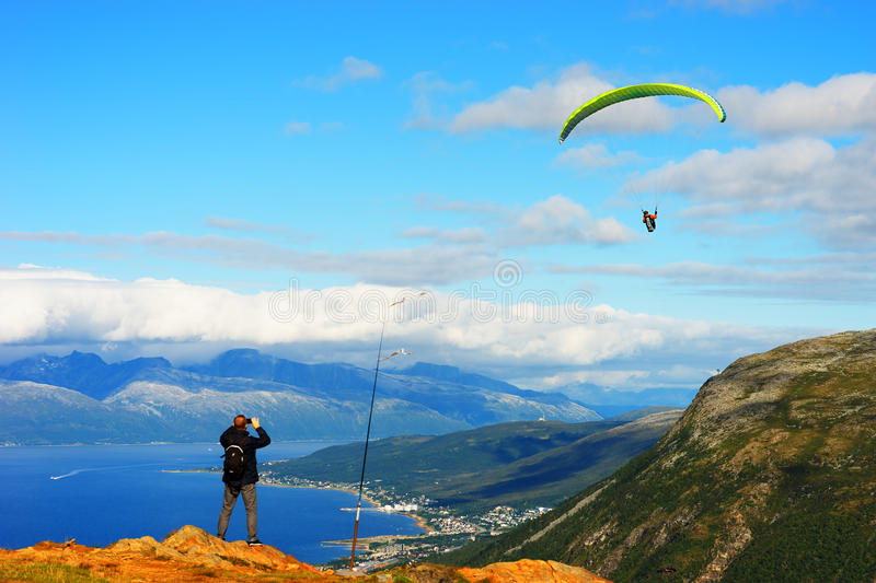 Man taking picture of Norway kite flyer background. Hd stock photography