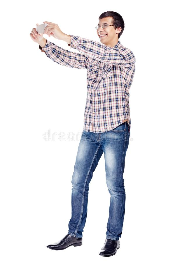 Man taking picture with phone full body royalty free stock photo