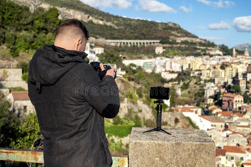 Man taking picture of Salerno city, Italy royalty free stock photo