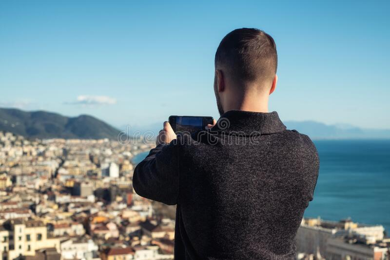 Man taking picture of Salerno city, Italy stock images