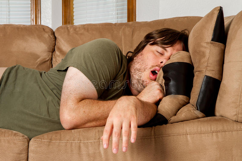 Download Man Taking A Quick Nap On The Couch Royalty Free Stock Images - Image: 25624839