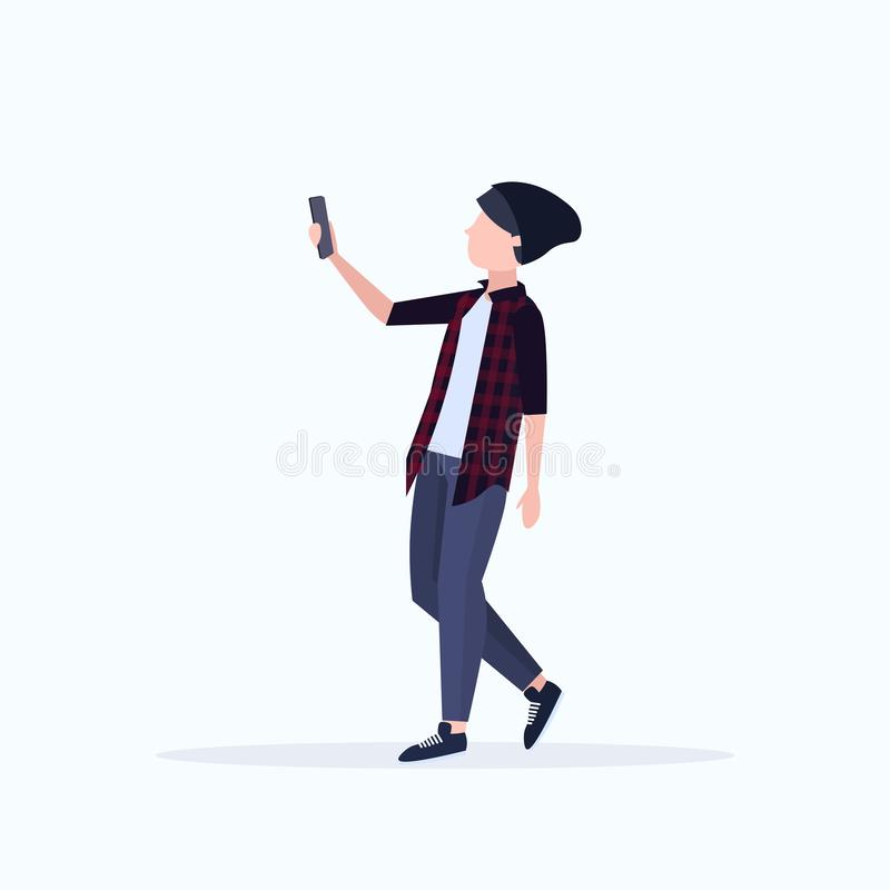 Man taking selfie photo on smartphone camera casual male cartoon character in hat posing on white background flat full. Length vector illustration stock illustration