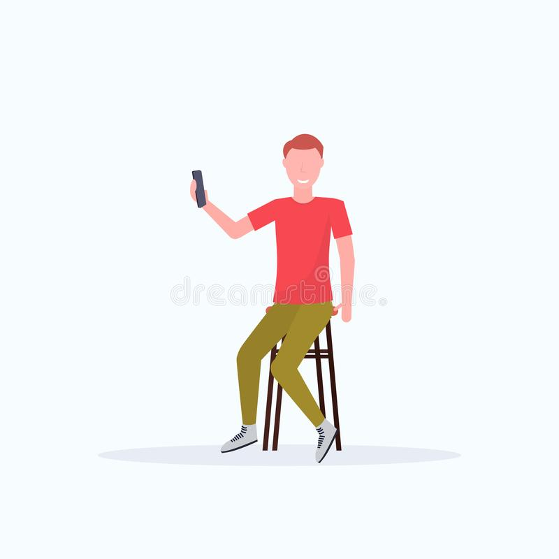 Man taking selfie photo on smartphone camera casual male cartoon character sitting on chair posing white background flat. Full length vector illustration royalty free illustration