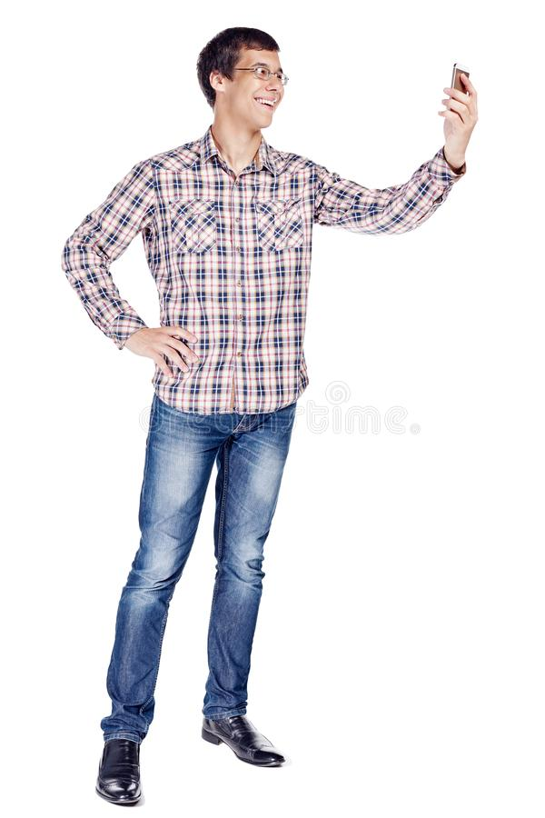 Man taking selfie with smartphone full body royalty free stock photos