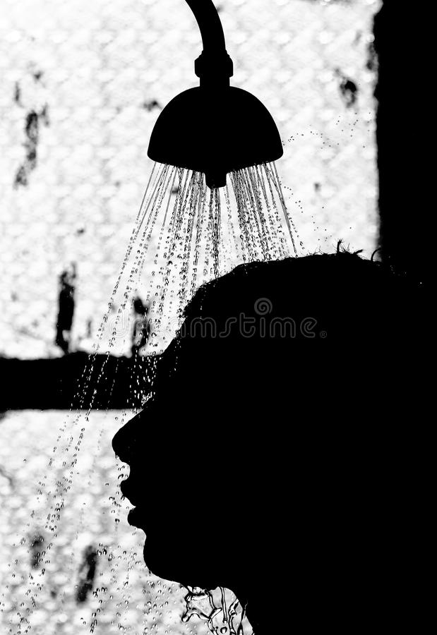 Man taking shower stock photos