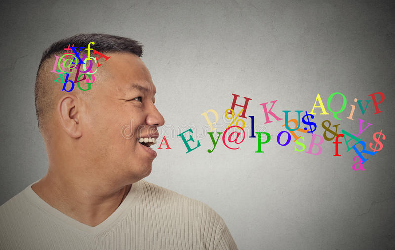 Man talking with alphabet letters coming out of open mouth royalty free stock image