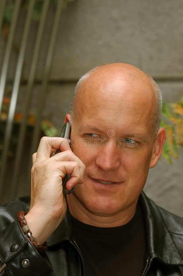 Man talking on a cell phone stock image