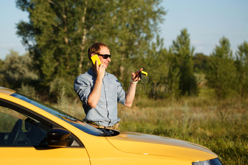 Man talking on phone at car stock photos