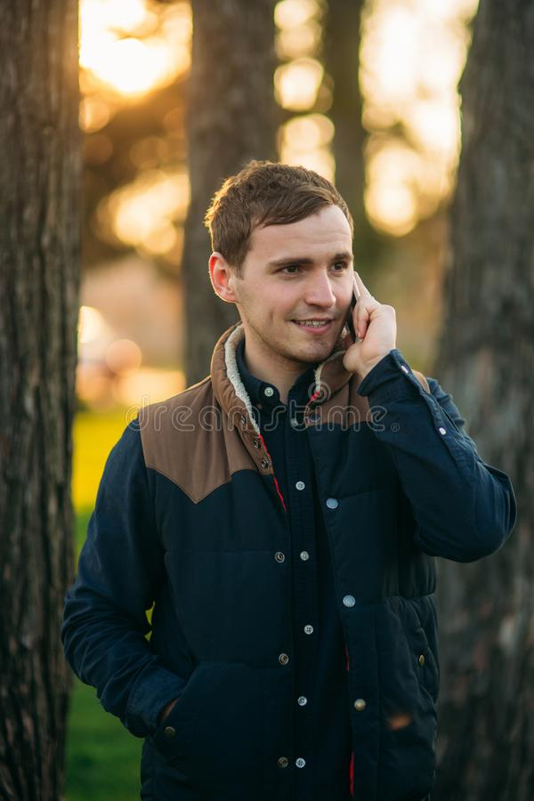 Free Man Talking On The Phone In The Park Stock Image - 147381111