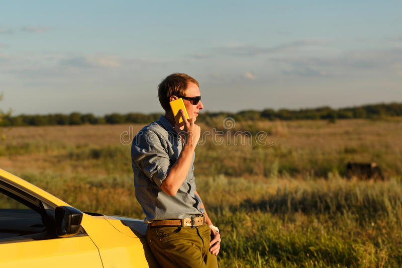 Man talking on phone at car royalty free stock photos