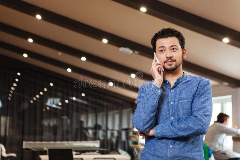 Man talking on the phone in office royalty free stock image