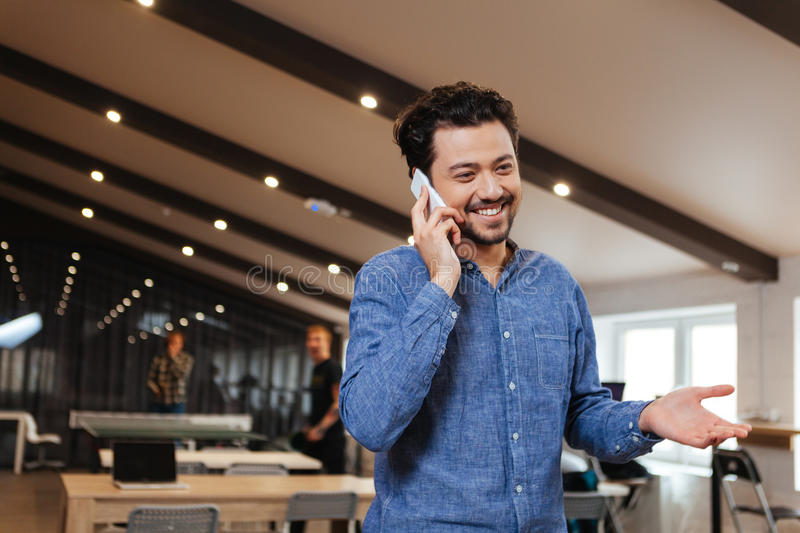 Man talking on the phone in office stock images