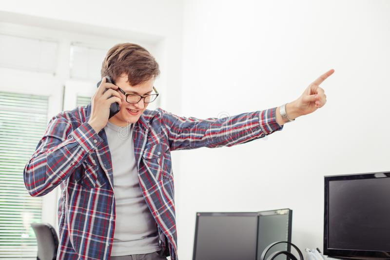 Man talking on the phone and receiving bad news stock photography