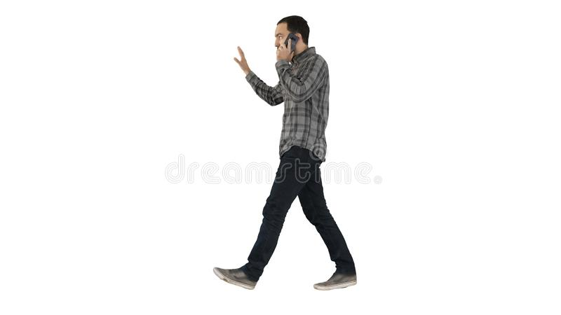 Man talking on phone, walking and making gestures on white background. stock images