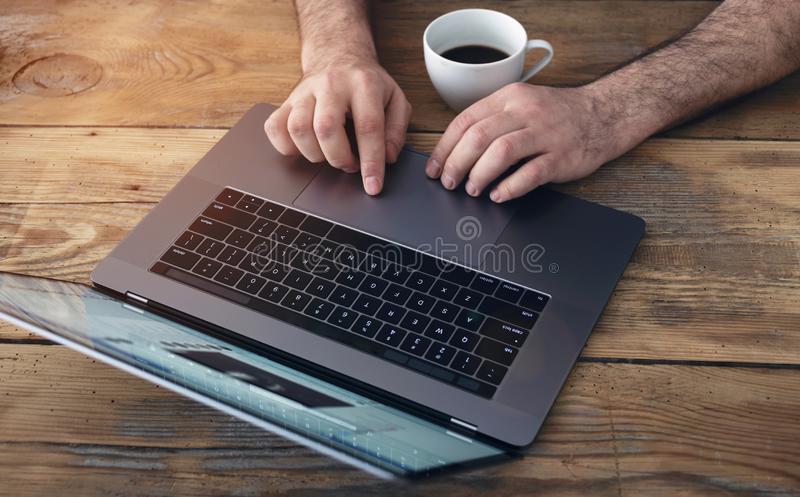 Man talking in real time in social networks. Male using laptop home office. Male hands typing on keyboard royalty free stock images