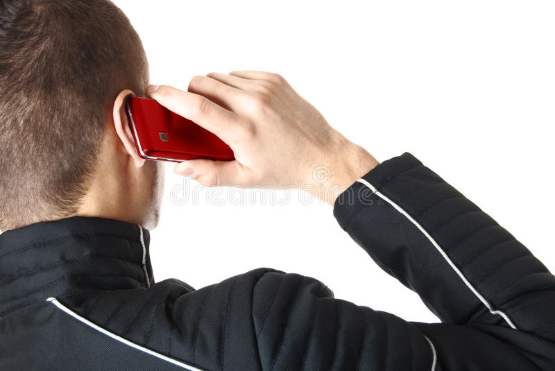 Man is talking on red smart phone   Isolated royalty free stock photos