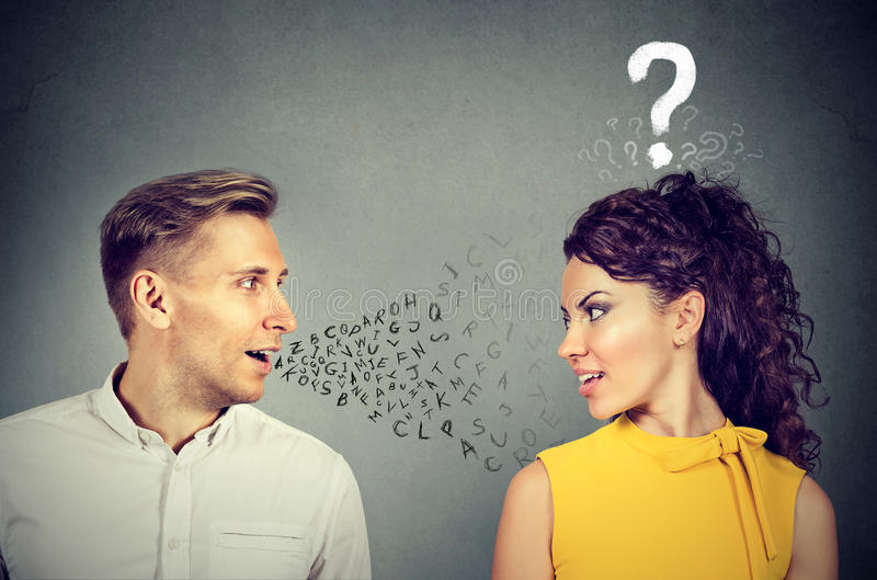 Man talking to an attractive woman with question mark. Handsome men talking to an attractive women with question mark royalty free stock photos