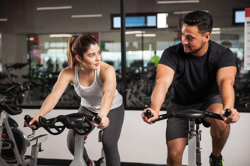 Man talking to a woman at the gym stock images