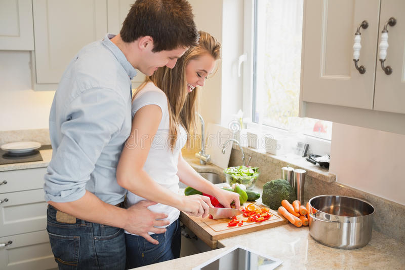 Man Talking With Woman While Cooking Stock Photo