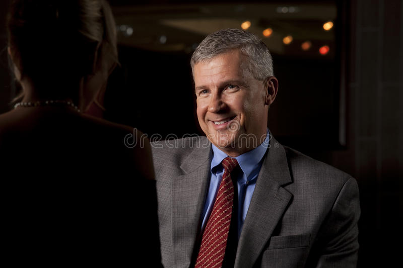 Download Man Talking With A Woman At A Restaurant/Bar Stock Photo - Image: 24627772