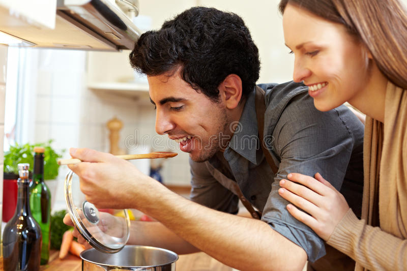 Download Man Tasting Soup In Kitchen Stock Photo - Image: 18670850