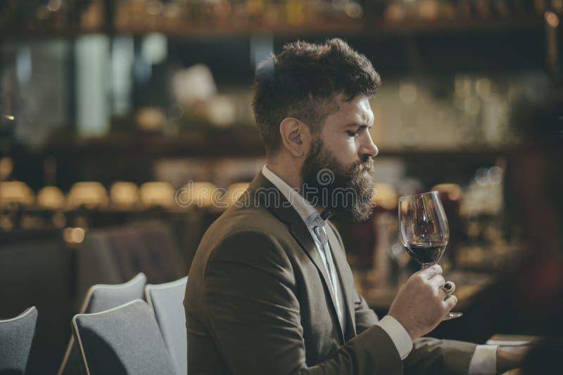 Man tasting wine in restaurant or bar interior.  stock image
