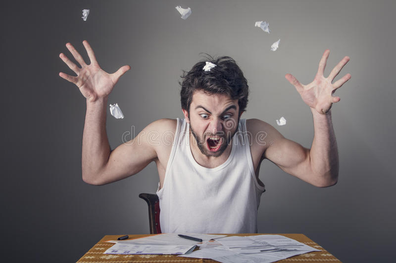 Man tearing apart bills royalty free stock photos
