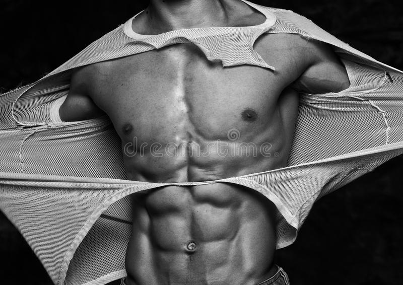 Download Man tearing off his shirt stock photo. Image of toned - 29182678