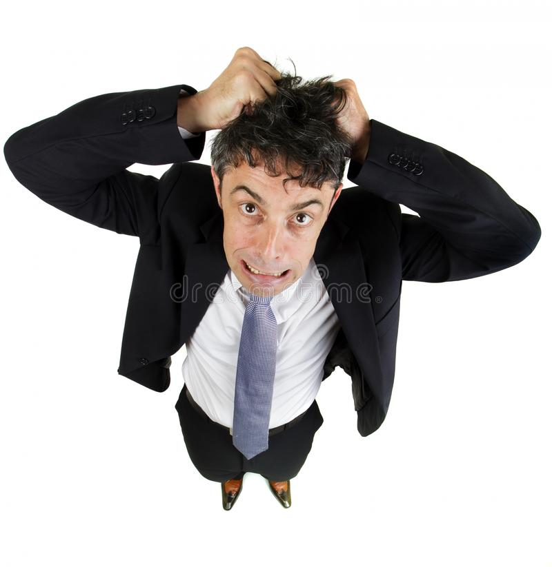 Man tearing out his hair. High angle fun portrait of a mature business man tearing out his hair in desperation and frustration isolated on white stock photography