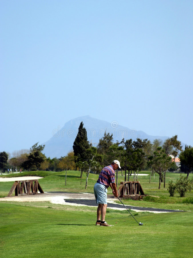 Man teeing off on golf course in sunny Spain stock photos