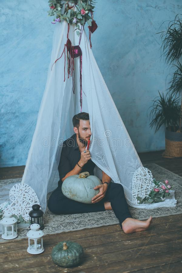 Man in a teepee stock photo