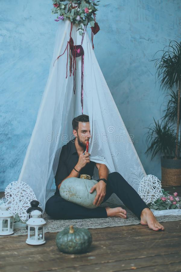 Man in a teepee. wedding in boho style stock images